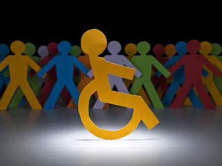 A disable paper figure stands under the spotlight on his wheelchair. photo