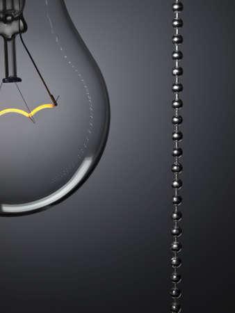 Vicino a una lampadina girata su con un interruttore a tirare su uno sfondo grigio.
