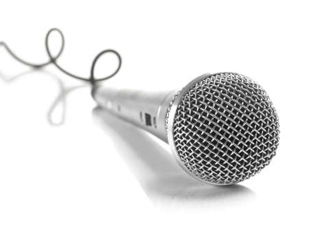A dynamic mic with a curled cable over white. photo