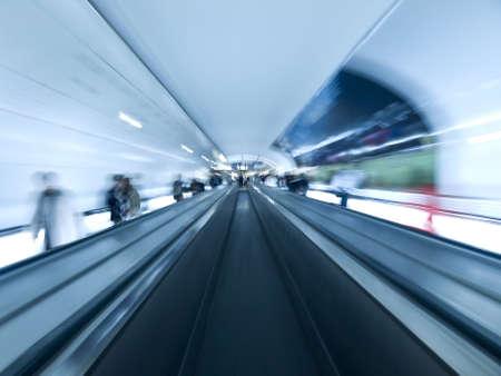 Futuristic image. Blurred people on the walkway tunnel. Empty center lane. Stock Photo - 5828703