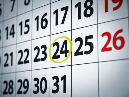 A date circled on a calendar with yellow ink. photo