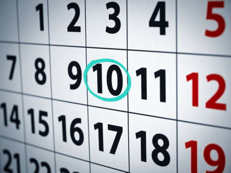 circled: Una fecha con un c�rculo en un calendario con tinta cian. Foto de archivo