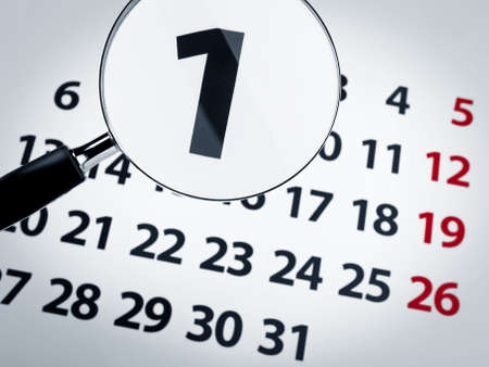 A magnifying glass on the 1st day of a calendar page. Stock Photo - 5997028