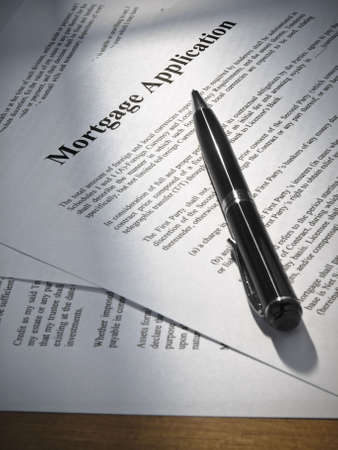 Close up on a mortgage application and a pen. photo