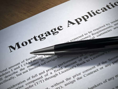 Close up of a mortgage application and a pen.