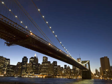brooklyn bridge: View of the Brooklyn bridge and south Manhattan from Brooklyn at dusk. Stock Photo