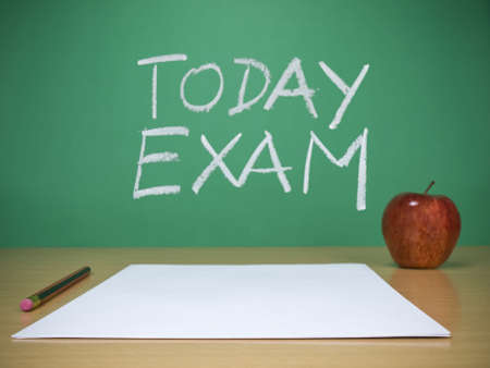 Blank sheets, a pencil and an apple over the desk. Today exam is written on the chalkboard as a background. Stock Photo - 6103356