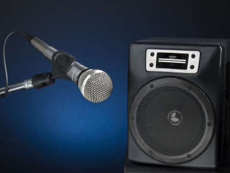 Professional microphone and speaker over a diffuse blue background. Stock Photo - 6103353