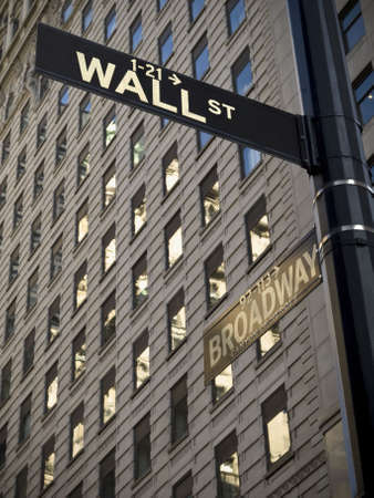 financial district: A Wall Street sign when it crossover with Broadway in Manhattan New York.