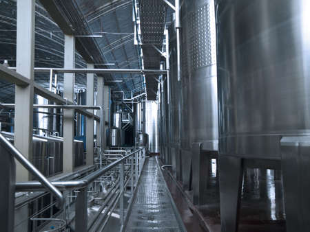 Stainless steel wine vats in a row inside the winery. Stock Photo - 6398337