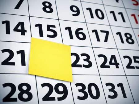 Close up of a blank sticky note on a calendar. photo