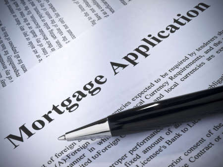 mortgage application: Close up of a mortgage application and a pen.