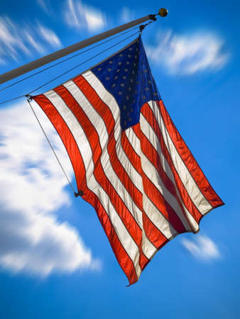 An american flag waving over a blue sky. Zooming effect. photo