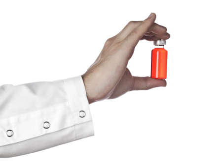 h1n1 vaccinations: A doctor holds a vial full of red liquid. Isolated on white.