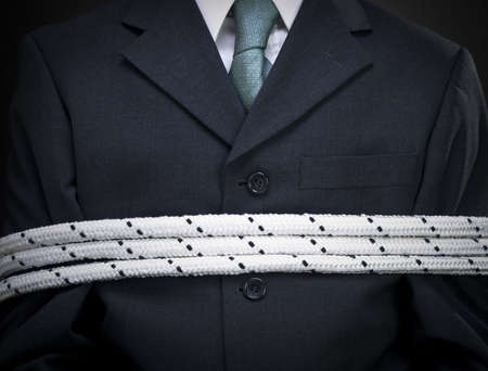 Closeup on the chest of a tied up businessman. Stock Photo - 6611455