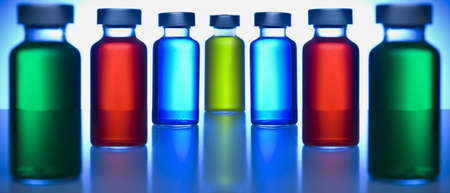 injectable: Two rows of vials filled with colored liquids. Focus on the blue ones.