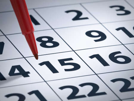 marker pen: Close up on a red marker pen ready to write on a calendar. Stock Photo