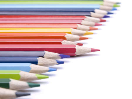 A red pencil comes out from the row of color pencils. photo