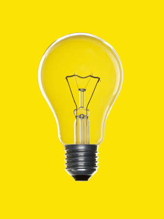 A light bulb over a yellow background. photo
