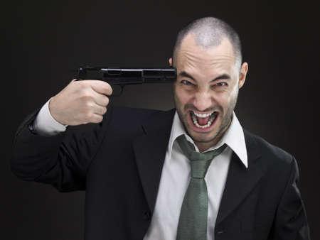 A desperate businessman attempts to commit suicide. photo