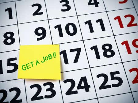 Get a job written on a sticky note on a calendar. photo