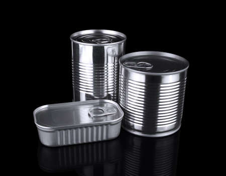 unopened: Three different unopened tin cans isolated on black.