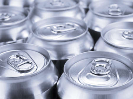 Several soda or beer cans. Shallow depth of field. Stock Photo