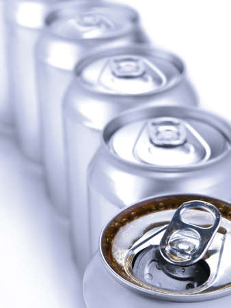 Close up view of a row of soda cans. Shallow depth of field. Stock Photo