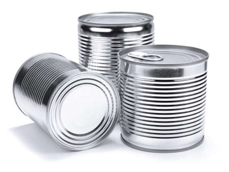 Three different unopened cans isolated on white. photo