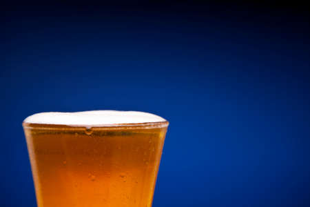 Close up on a full glass of beer. Copy space. Stock Photo - 22224445