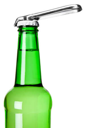 A bottle opener on top of a beer bottle. photo