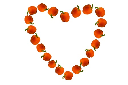 allocated: Valentine of paprika executed in the form of hearts on a white background  Beautiful Valentine made of paprika allocated on a white background