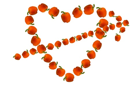 allocated on white: Valentine of paprika, made in the shape of a heart with an arrow from the paprika on a white background  Beautiful Valentine made of paprika allocated on a white background