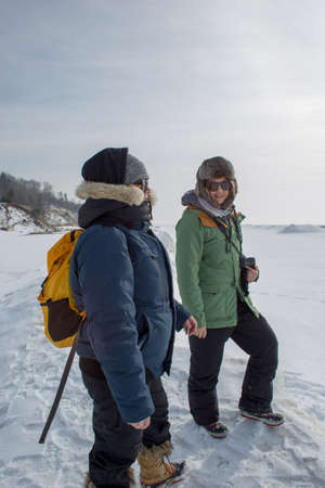 Adventurous woman smiling in frozen landscape Stock Photo