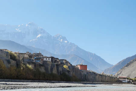 snowcovered: Mountain river in the Himalayas with the eight-thousand-meter Dhaulagiri in the background