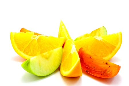 expanded: bright fruit slices lie around on a bright white background