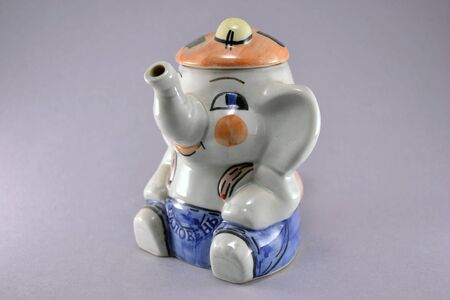 infuser: Tea infuser ceramic elephant for decoration of home cooking Stock Photo