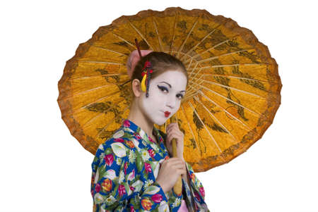 A beautiful blonde woman wearing a Japanese costume photo