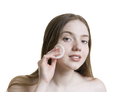 A young beautiful woman taking care of her skin.