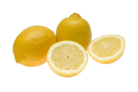 Three lemons one of which is divided in half Stock Photo