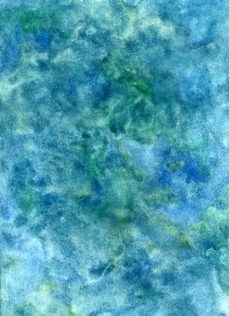 Un tessuto blu dipinto a mano con acquarelli su carta bagnata
