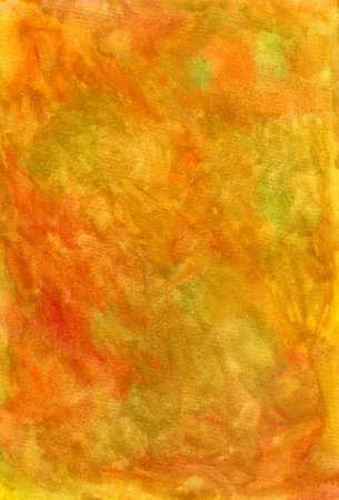 Un dipinto a mano con tessuto giallo, verde e arancione acquarelli su carta bagnata