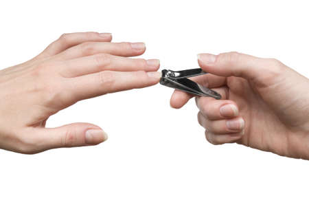 Manicure - cutting off extra nails with a nail clipper