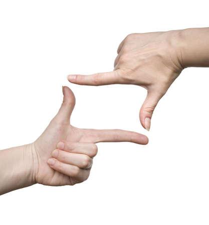 Telaio realizzato con le dita di una donna isolata su sfondo bianco
