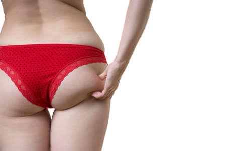 femme se deshabille: Jeune femme de mesure sur sa fesse cellulite, isol�. Banque d'images