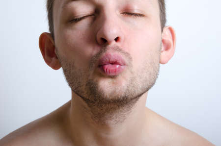 nose close up: Handsome unshaved man ready to be kissed. Close up. Focus on lips. Stock Photo