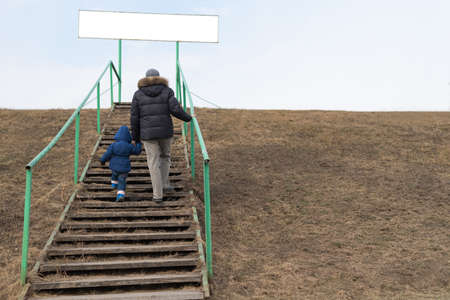 going: Father and child on a staircase in spring Stock Photo
