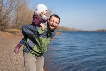 father daughter: Father playing with his daughter on a riverbank Stock Photo