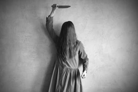 wicked problem: Furious woman with a knife. Her face is covered with hair. Retouched and vignette is added.