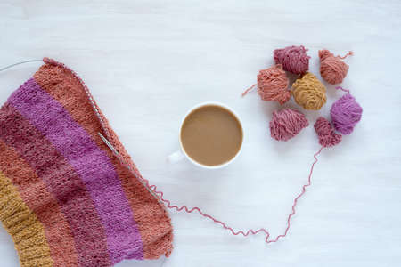 weave ball: Cup of coffee and colorful knitting on white background Stock Photo